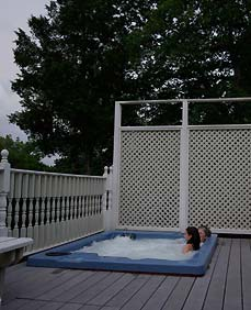 Soak your cares away in our outdoor hot tub - Plain & Fancy BB